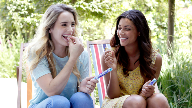 Image of two women enjoying Mentos